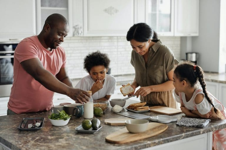 Happy Family in Kitchen Home