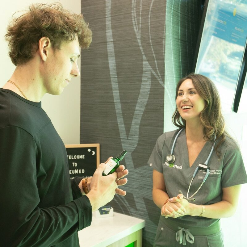 NeuMed Nurse Practitioner Talking With Patient